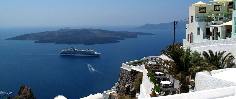 A panoramic view from Fira on Santorini looking at the Nea Kameni Volcanic Island