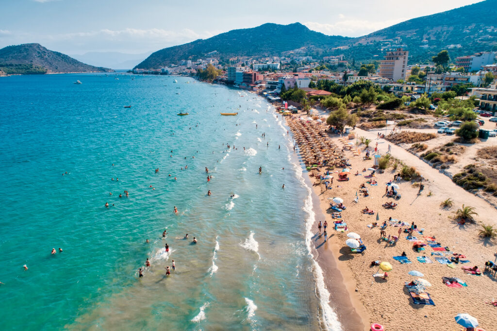 """Top view of Tolo beach or """"Psili Ammos"""" is from the most popular tourist resorts of Argolida in Peloponnese, Greece"""