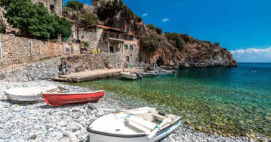 Boats on the shore in Alypa Beach, Mania Peninsula, Lakonia, Peloponnese, Greece, a beautiful stone beach in Mani peninsula, Greece