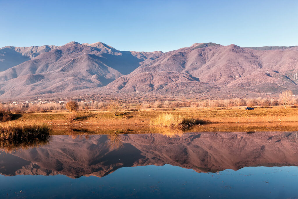 Reflection of mountains on Kerkini lake, Serres in northern Greece
