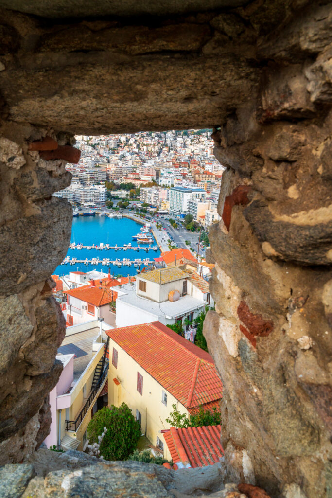 Aerial view from the window of old castle of Kavala with marina and seafront promenade, the city of Kavala, northern Greece