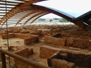 The ruins of Malia palace under semi-transparent roofs, Crete