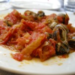 Snails in tomato, traditional Cretan dish