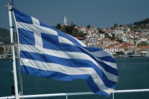 Greek Flag on the ferry toward Poros island, Saronic Gulf, Greece