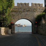 Looking out at the harbor through the old city wall in Rhodes