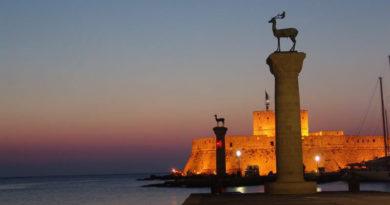Mandraki harbor during night, Rhodes city, Greece