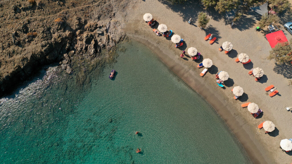 Drone view of the sandy beach of Steno next to the small chapel of Agios Mamas in Astypalea, Dodecanese Greece