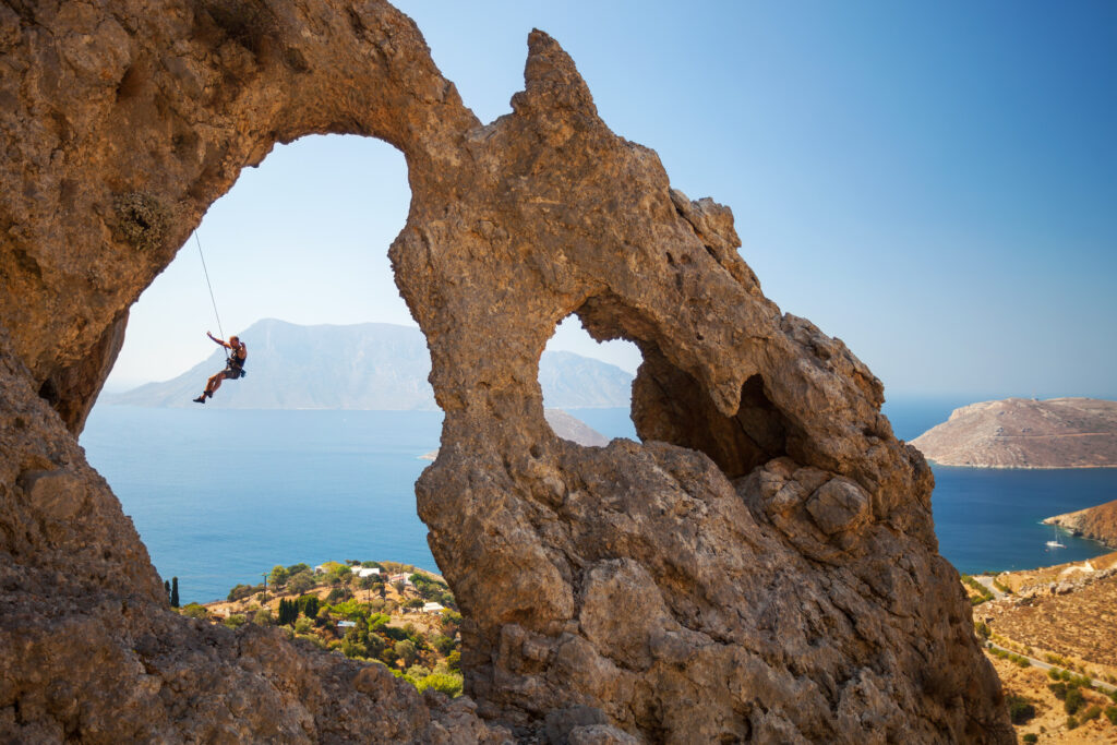 "Rock climber at the ""Palace"", one of the most impressive rock formations in Kalymnos, Dodecanese, Greece"