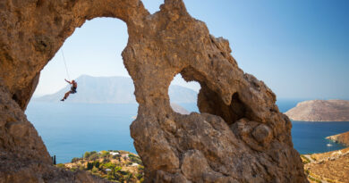 """Rock climber at the """"Palace"""", one of the most impressive rock formations in Kalymnos, Dodecanese, Greece"""