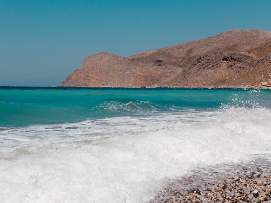 Pebbled beach in Tilos island, Dodecanese Greece