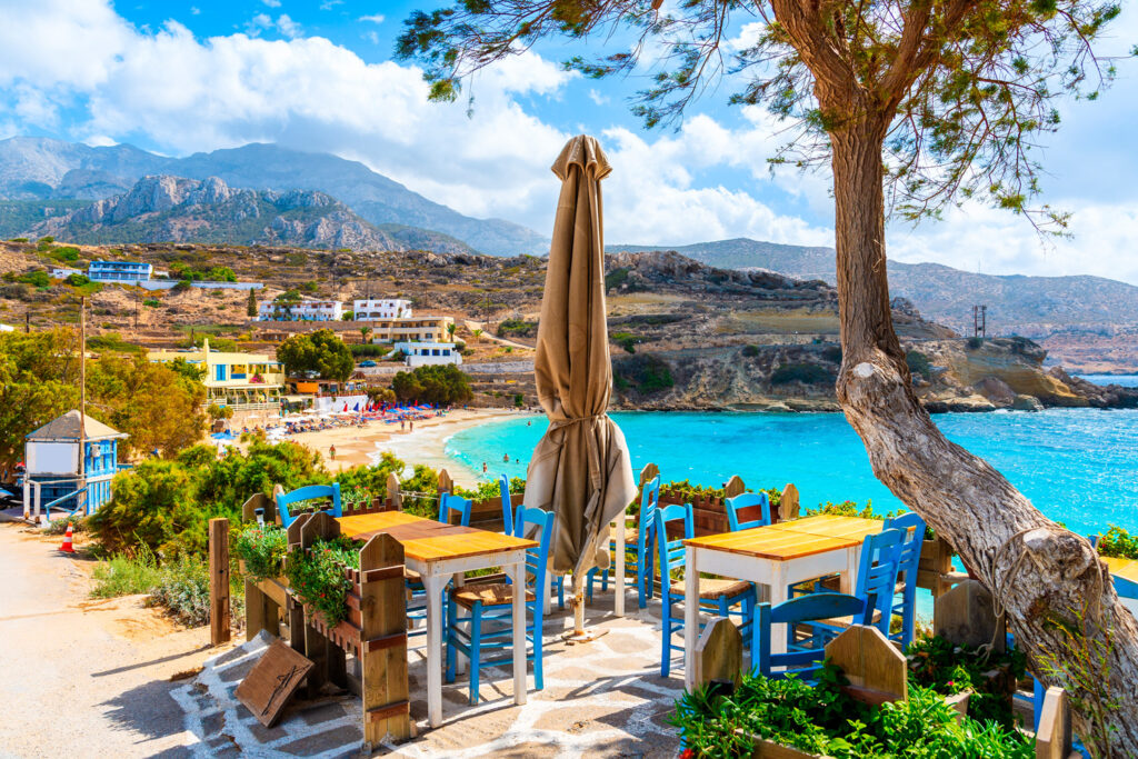 Tavern on terrace with view to Lefkos beach in Karpathos, Dodecanese Greece