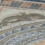 A mosaic on the floor of a former house representing dolphins, Delos, Cyclades, Greece