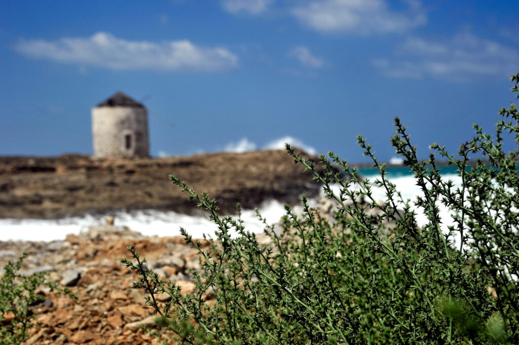 Seascape with old windmill in Kasos island, Dodecanese Greece