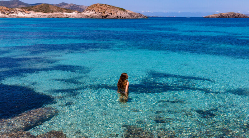 Travel to Antiparos, Cyclades, Greece - Woman in the crystal clear water at Antiparos