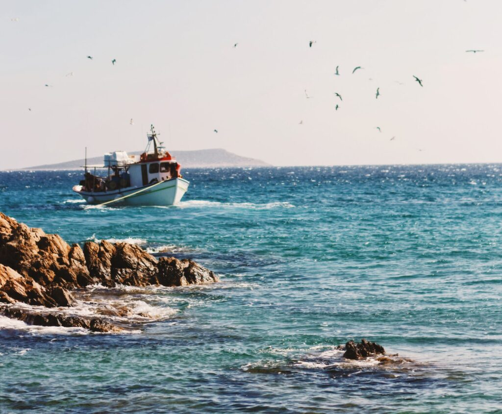Travel to Antiparos, Greece - fishingboat - Photo by Alex Voulgaris