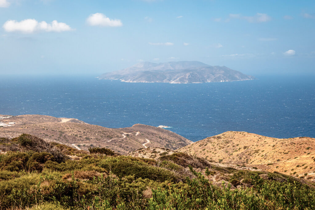 A view of the west coast of Ios Island. Sikinos Island in the background. Cyclades, Greece