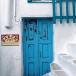 Bakery in Mykonos. It is one of the famous colored doors of the waterfront Greek town.