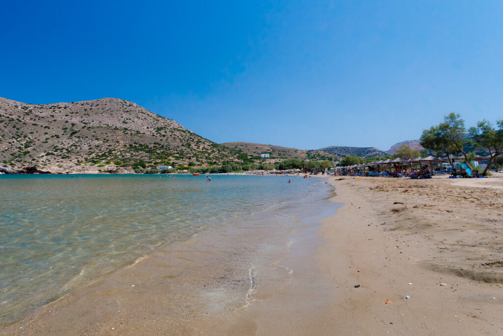 Beautiful beach of Galissas in Syros island, Greece against a clear blue sky. Galissas is one of the few sand beaches in Syros island with crystal clear blue waters.
