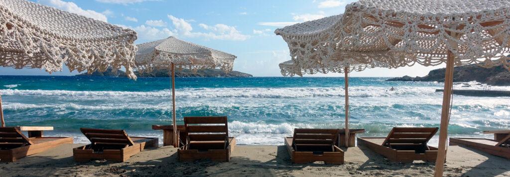 Big waves crash onto the beach of Possidonia, Syros, Greece
