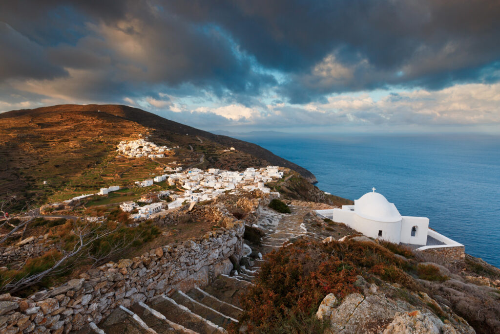 Church over village of Kastro on Sikinos island early in the morning. Cyclades Greece
