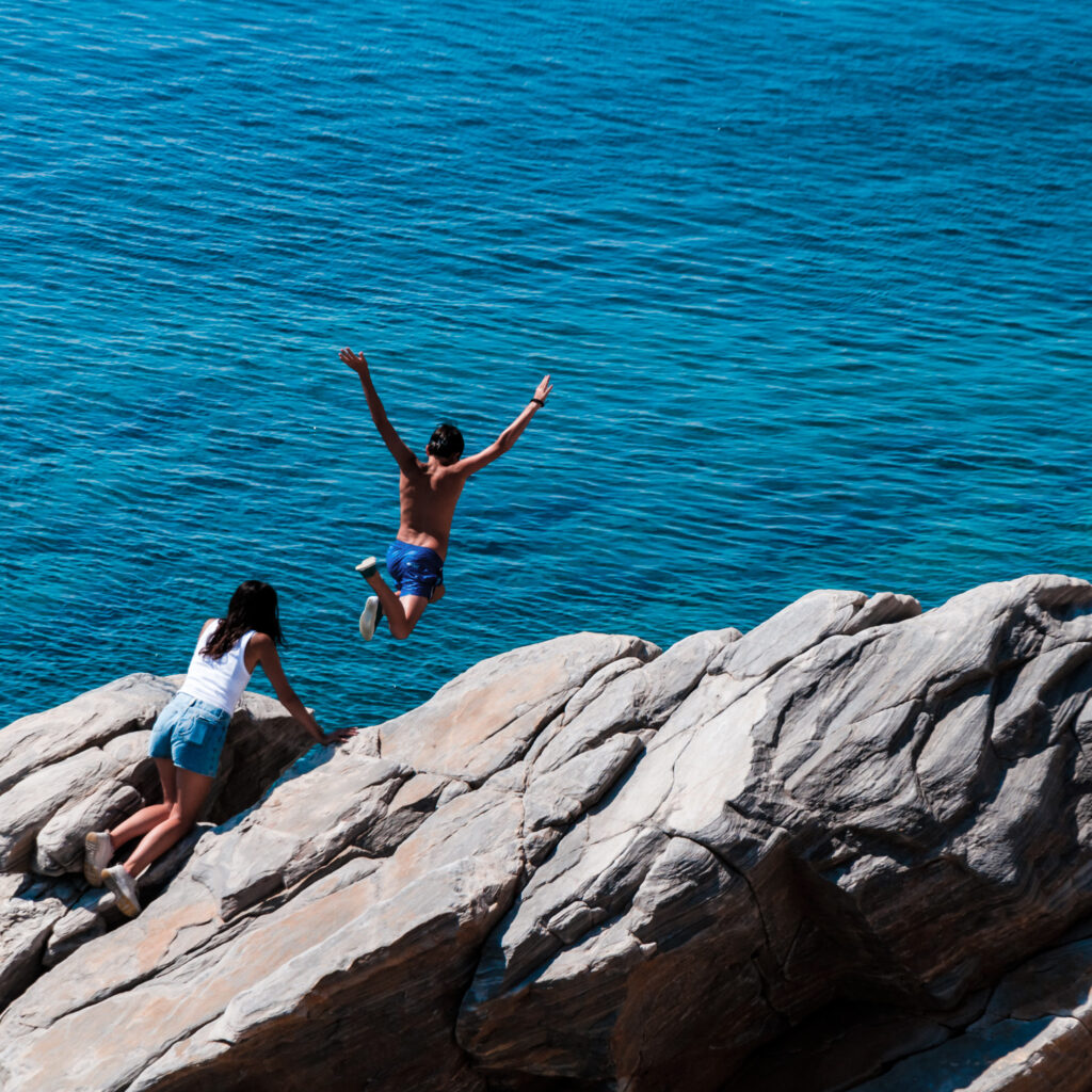 Cliff diving in Sikinos, Greece