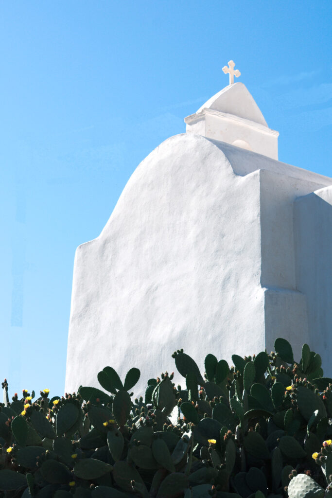 A whitewashed chapel in the old Kastro. The brilliant white of the building contrasts with the clear blue sky, Sikinos Greece