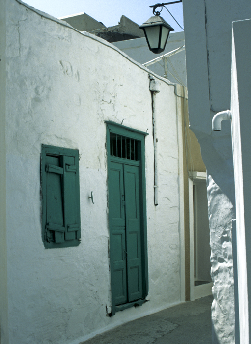 Green door at a cobbled street in the old town of Ano Syros, Greece