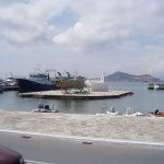 Naxos port with the tiny islet of Church Myrtidiotissa