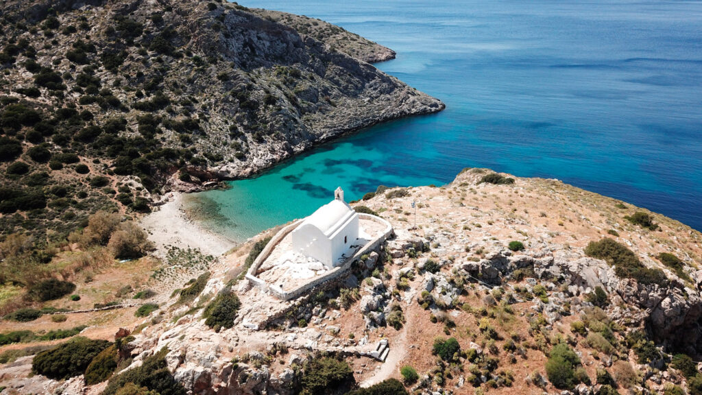 Aerial view of Galissas beach withthe small picturesque chapel of Agios Pakos, Syros island, Cyclades, Greece
