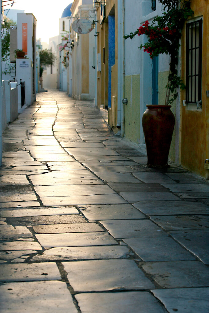 Alley in Oia Santorini at sunrise, Cyclades Greece