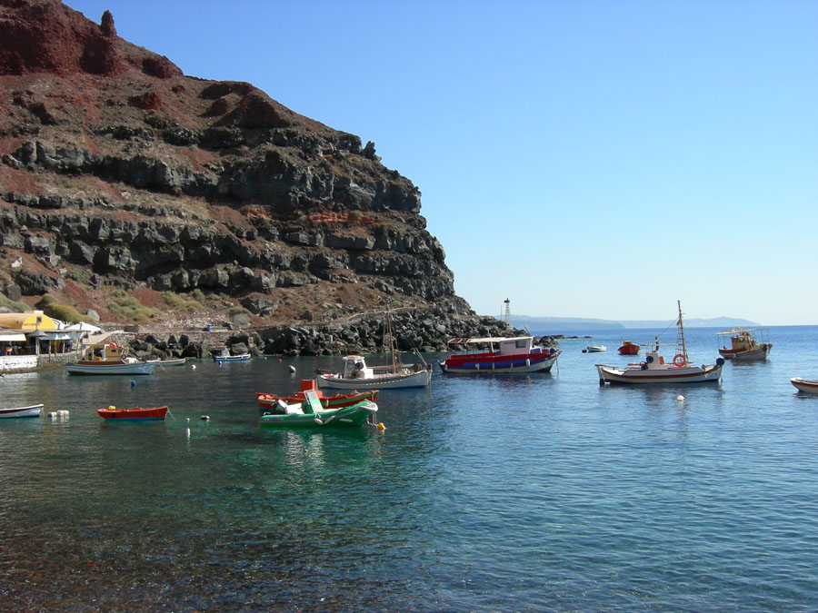 Santorini coast with fishing boats