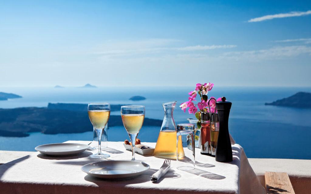 Table for two above the Aegean Sea, Santorini. Greece