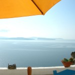 Under the umbrella on one of the many Santorini terraces