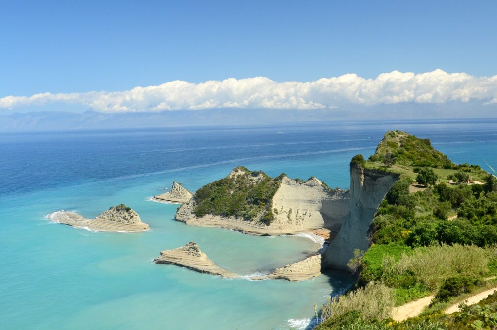 travel to Corfu, Greece - clear blue sea and cliffs