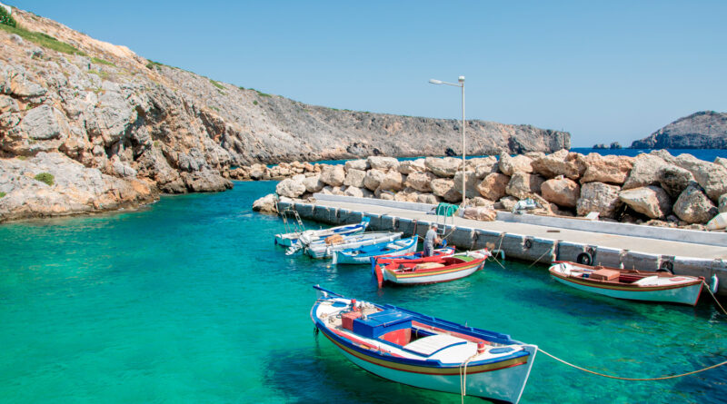 Tiny port with colourful fishing boats at Potamos village in Antikythera, a remote island between Kythira and Crete, Greece