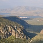 View from Delphi to the olive groves and the sea in the distance