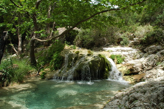 "The ""Neraida"" or ""Fonissa"" waterfall is situated among huge plane trees in Mylopotamos in Kythira island Greece"