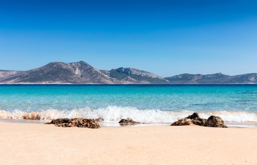 Beautiful blue and turquoise waters at Plateia Pounta beach at Koufonisi Island, Greece