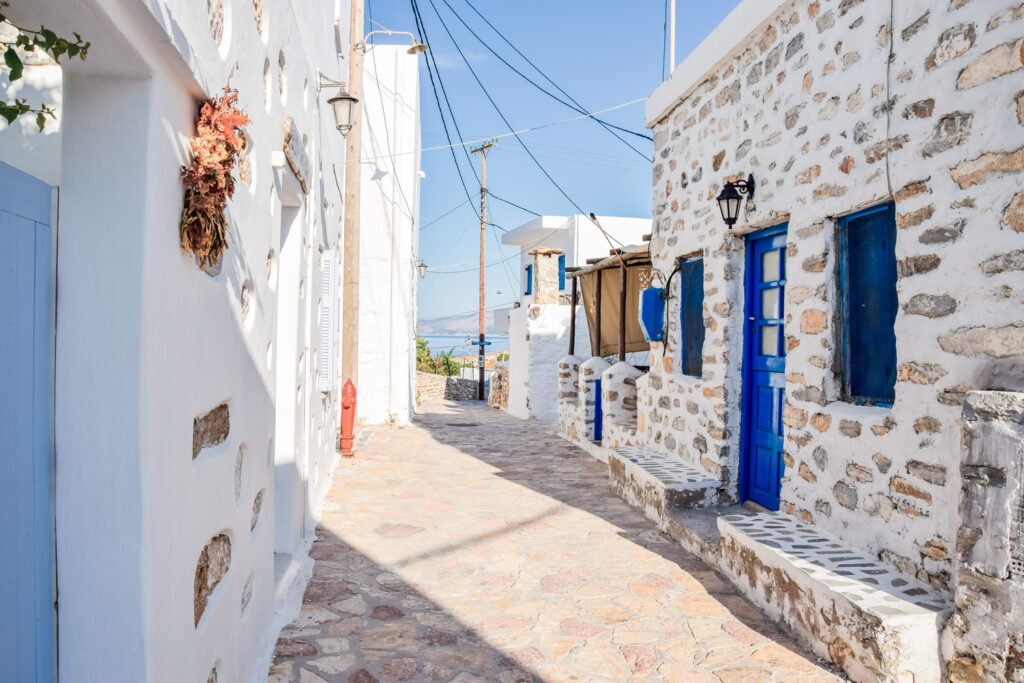 Traditional cobbled street with stone buildings in Chora Koufonisia, Small Cyclades, Greece