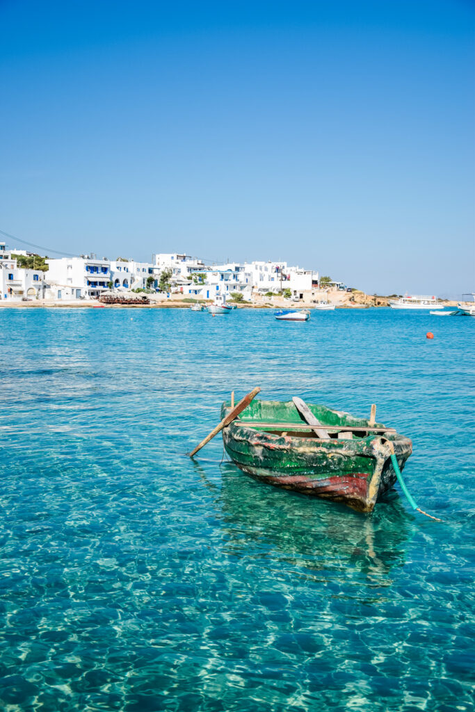 Old boat in turquoise waters at Koufonisia, Smaller Cyclades, Greece