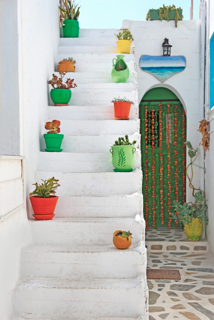 traditional stairs with flower pots in Pano Koufonisi island, Smaller Cyclades Greece