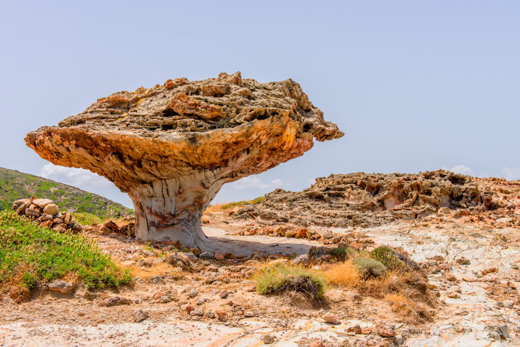 Skiadi stone - a giant lump in the shape of a mushroom, a unique natural attraction of the island of Kimolos, Cyclades, Greece