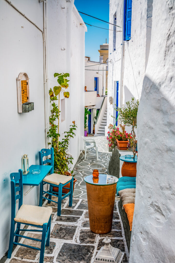 View of cafe in alley in Chorio Kimolou Cyclades Greece