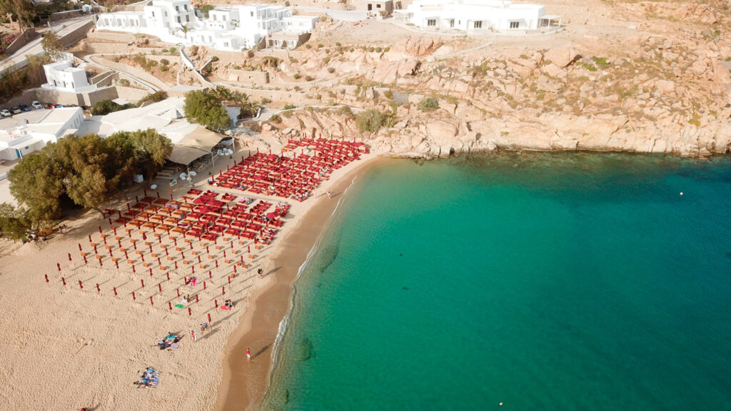 Iconic and famous beach of Super Paradise with sapphire clear waters, Mykonos island, Cyclades, Greece