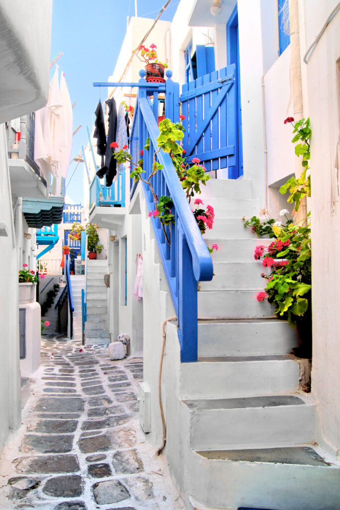Beautiful whitewashed alley in the old town of Mykonos, Cyclades Greece
