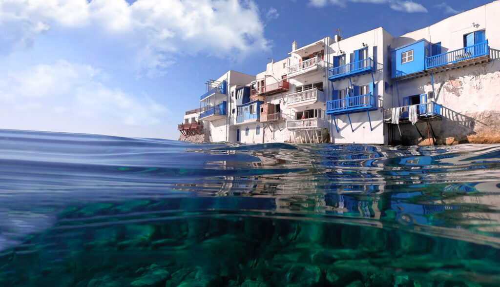 Emerald waters at Little Venice, the iconic landmark of Mykonos island, Cyclades Greece