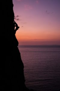 Rock climbing in the sunset on Kalymnos, Dodecanese, Greece