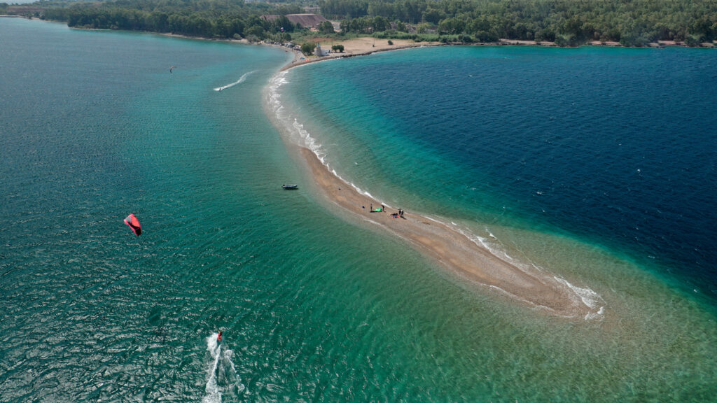 Aerial view of popular to kite surfers sand bar and beach of Cape Drepano, Achaia, Patra, Greece