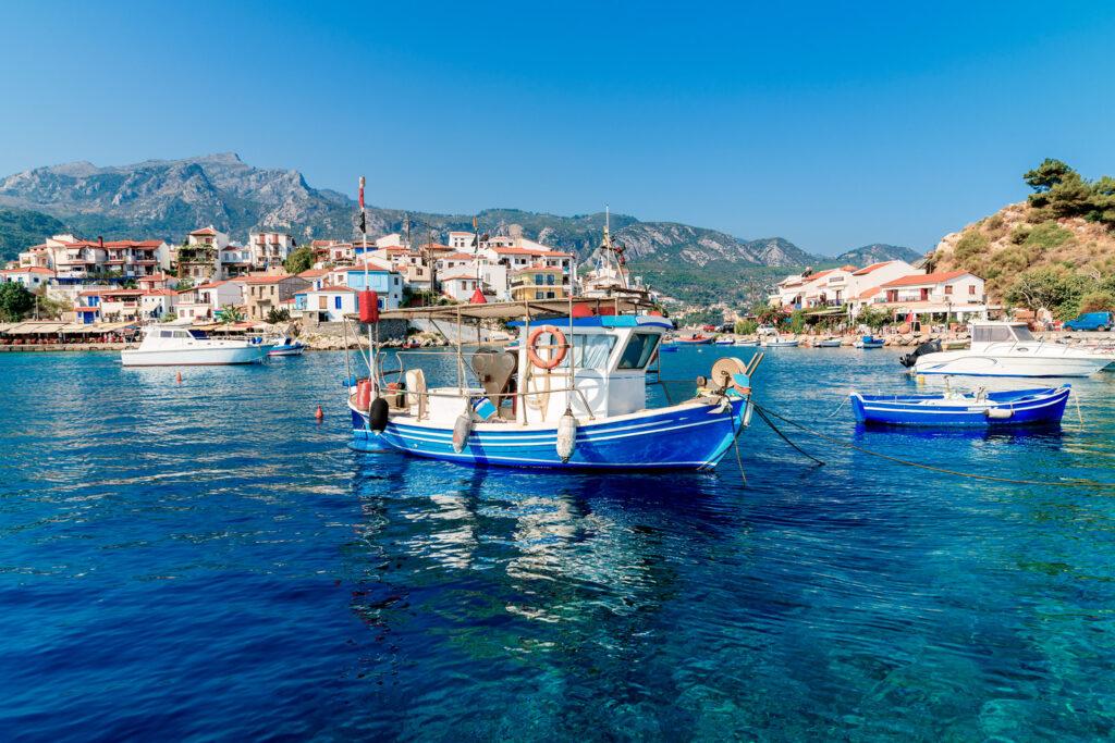 Fishing boats in Kokkari port in Samos island, Aegean Sea Greece