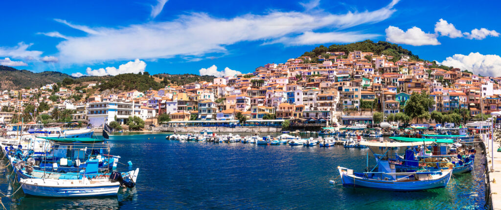 Colourful Plomarion town with traditional fishing boats, North Aegean Sea Greece
